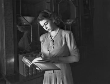 Princess Elizabeth reading a book in Buckingham Palace on July 19, 1946. (Photo by Lisa Sheridan/Studio Lisa/Getty Images)